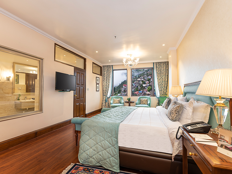 Possess the inspiring view of the town from the premium double Room of The Elgin luxury Hotel in Darjeeling
